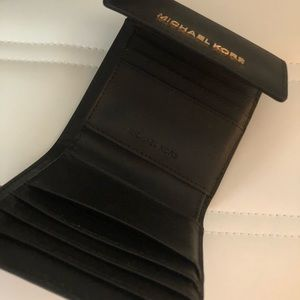 Michael Kors black wallet with snap close